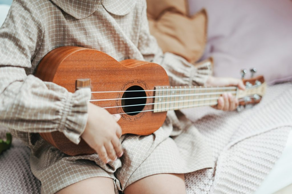 child playing musical instrument