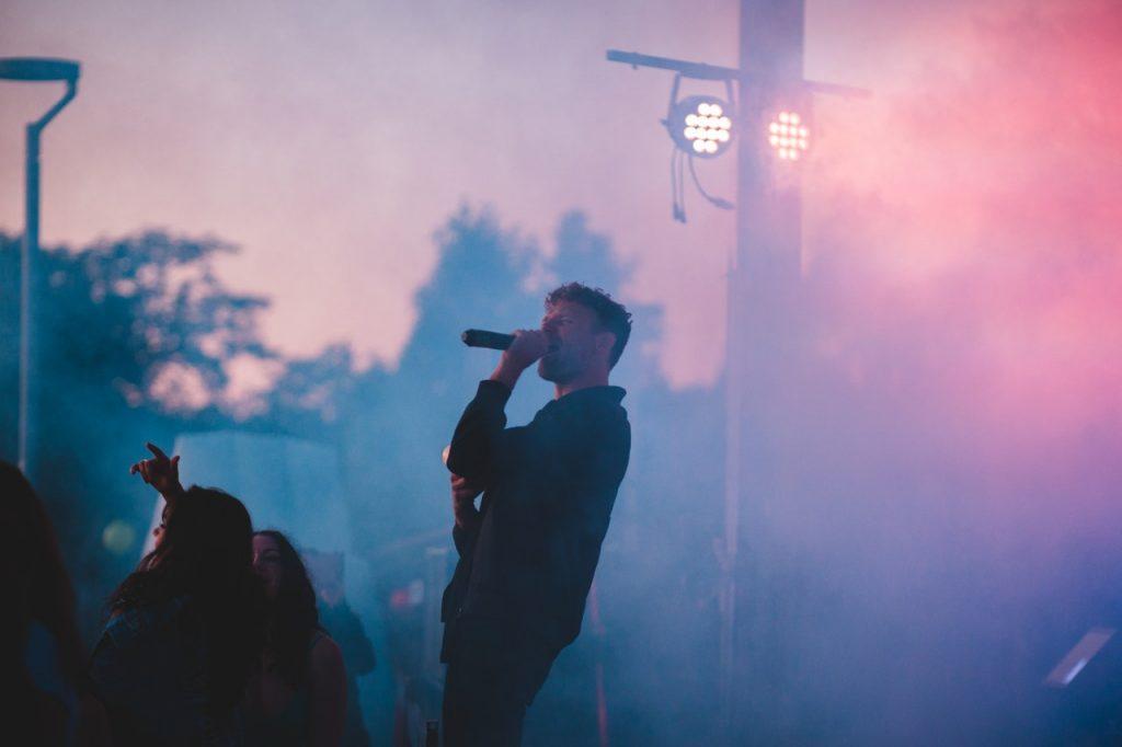man singing in music festival